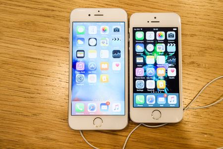 retina display: PARIS, FRANCE - APR 4, 2016: Flagship iPhone 6 S under the new Apple iPhone SE during the sales launch of the latest Apple Inc. smartphone and iPad Pro at the Apple store in Paris, France