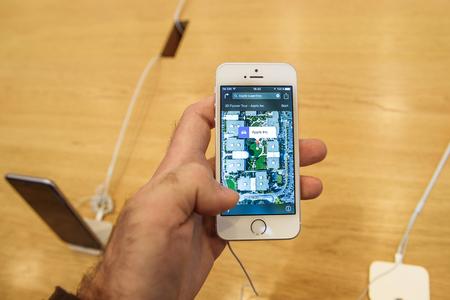 retina display: PARIS, FRANCE - APR 4, 2016: Cupertino 3d Flyover map on the new Apple iPhone SE during the sales launch of the latest Apple Inc. smartphone and iPad Pro at the Apple store in Paris, France
