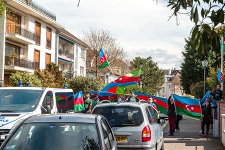 azerbaijani: STRASBOURG, FRANCE - APR 8, 2016: Azerbaijani diaspora protest outside Azerbaijan Embassy against the 2013 clashes in Nagorny-Karabakh, the region disputed by Armenia and Azerbaijan After