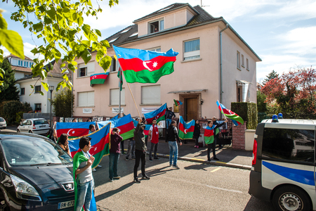 disputed: STRASBOURG, FRANCE - APR 8, 2016: Azerbaijani diaspora protest outside Azerbaijan Embassy against the 2013 clashes in Nagorny-Karabakh, the region disputed by Armenia and Azerbaijan After