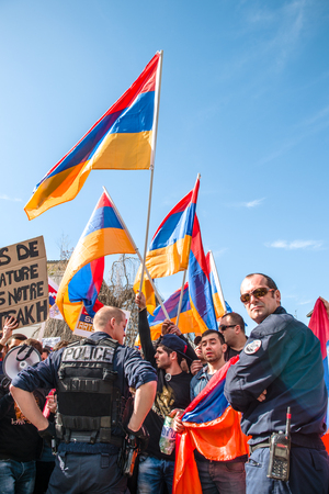 clashes: STRASBOURG, FRANCE - APR 8, 2016: Armenian diaspora protest outside Azerbaijan Embassy against the 2016 clashes in Nagorny-Karabakh, the region disputed by Armenia and Azerbaijan