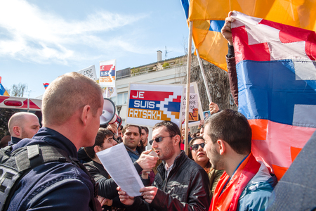 disputed: STRASBOURG, FRANCE - APR 8, 2016: Armenian diaspora protest outside Azerbaijan Embassy against the 2016 clashes in Nagorny-Karabakh, the region disputed by Armenia and Azerbaijan