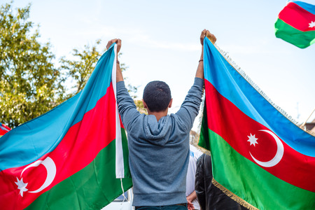 clashes: STRASBOURG, FRANCE - APR 8, 2016: Azerbaijani diaspora protest outside Azerbaijan Embassy against the 2013 clashes in Nagorny-Karabakh, the region disputed by Armenia and Azerbaijan After