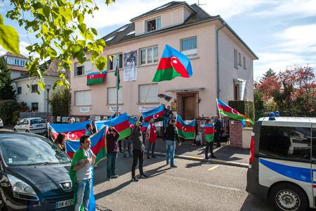 diaspora: STRASBOURG, FRANCE - APR 8, 2016: Azerbaijani diaspora protest outside Azerbaijan Embassy against the 2013 clashes in Nagorny-Karabakh, the region disputed by Armenia and Azerbaijan After