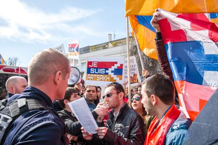 STRASBOURG, FRANCE - APR 8, 2016: Armenian diaspora protest outside Azerbaijan Embassy against the 2016 clashes in Nagorny-Karabakh, the region disputed by Armenia and Azerbaijan