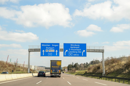 western script: GERMANY - MAR 26, 2016: Bundesautobahn or Federal Motorway highway street signsign. It runs through the German states of Hessen and Baden-Württemberg and connects on its southern ending to the Swiss A 2.Construction was started on 23 September 1933 by
