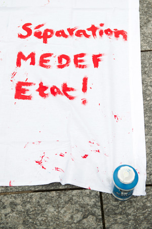 enterprises: STRASBOURG, FRANCE - APR 9, 2016: French placard reading Separation of MEDEF (Movement of the Enterprises of France) from the state during public placard drawings in Place Kleber