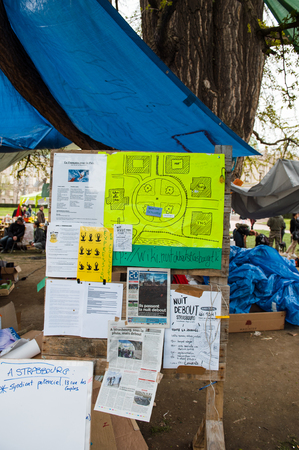 manifests: STRASBOURG, FRANCE - APR 9, 2016: Manifests and banners seen during Nuit Debout or Standing night movement at the Place de la Republique in Strasbourg