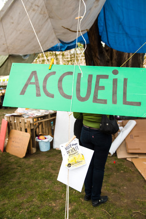 standing reception: STRASBOURG, FRANCE - APR 9, 2016: Reception hand made sign at the entrance of Nuit Debout or Standing night movement at the Place de la Republique in Strasbourg Editorial
