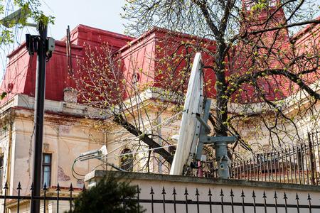 sattelite: Large parabolic satellite antenna in the backyard of a house Stock Photo