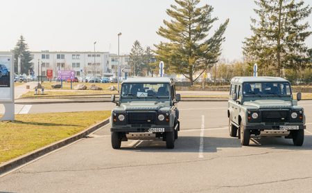 solider: STRASBOURG, FRANCE - MAR 20, 2016: Two vigipirate military Land Rover jeep parked in the Entzheim Aeroport Strasbourg France parking area while soliders search for possible terrorists and for the security of the passengers