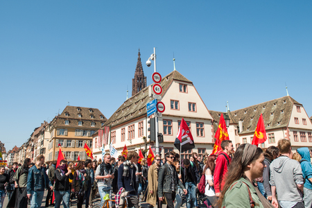 protesting: STRASBOURG, FRANCE - APR 20, 2016: People protesting in center of Strasbourg as part of nationwide day of protest against proposed labor reforms by Socialist Government