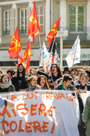 proposed: STRASBOURG, FRANCE - APR 20, 2016: Crowd yelling as hundreds of people demonstrate as part of nationwide day of protest against proposed labor reforms by Socialist Government