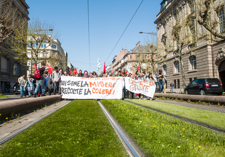 proposed: STRASBOURG, FRANCE - APR 20, 2016:Blocked tramway line as hundreds of people demonstrate on tram lines as part of nationwide day of protest against proposed labor reforms by Socialist Government Editorial