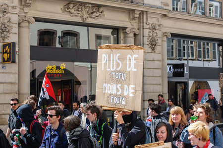 reforms: STRASBOURG, FRANCE - APR 20, 2016: Closed street as hundreds of people demonstrate as part of nationwide day of protest against proposed labor reforms by Socialist Government