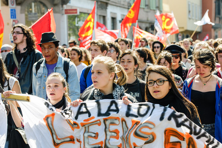 central government: STRASBOURG, FRANCE - APR 20, 2016: Closed central street as hundreds of people demonstrate as part of nationwide day of protest against proposed labor reforms by Socialist Government