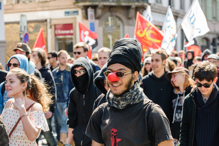 nationwide: STRASBOURG, FRANCE - APR 20, 2016: Man wearing clown nose as hundreds of people demonstrate as part of nationwide day of protest against proposed labor reforms by Socialist Government Editorial