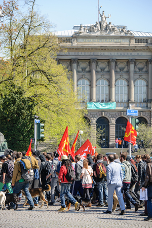 nationwide: STRASBOURG, FRANCE - APR 20, 2016: Hundreds of students demonstrate in front of University of Strasbourg as part of nationwide day of protest against proposed labor reforms by Socialist Government