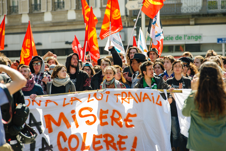 socialist: STRASBOURG, FRANCE - APR 20, 2016: Crowd yelling as hundreds of people demonstrate as part of nationwide day of protest against proposed labor reforms by Socialist Government
