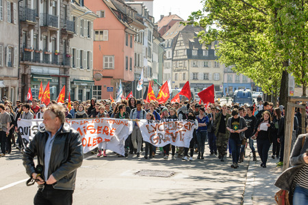 nationwide: STRASBOURG, FRANCE - APR 20, 2016: Closed main Strasbourg street as hundreds of people demonstrate as part of nationwide day of protest against proposed labor reforms by Socialist Government