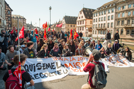 nationwide: STRASBOURG, FRANCE - APR 20, 2016: Die-in on central Strasbourg as hundreds of people demonstrate as part of nationwide day of protest against proposed labor reforms by Socialist Government Editorial