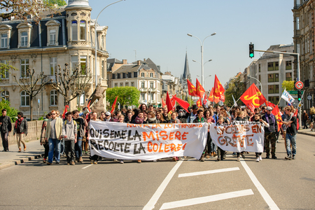 proposed: STRASBOURG, FRANCE - APR 20, 2016: Closed Avenue des Vosges as hundreds of people demonstrate as part of nationwide day of protest against proposed labor reforms by Socialist Government