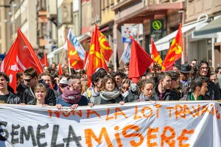 central government: STRASBOURG, FRANCE - APR 20, 2016: Central street of Rue du Vieux Marche aux Poissons closed as hundreds demonstrate as part of nationwide day of protest against proposed labor reforms by Socialist Government