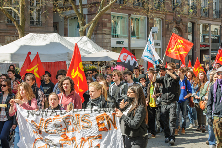 proposed: STRASBOURG, FRANCE - APR 20, 2016: Marching on street as hundreds of people demonstrate as part of nationwide day of protest against proposed labor reforms by Socialist Government Editorial