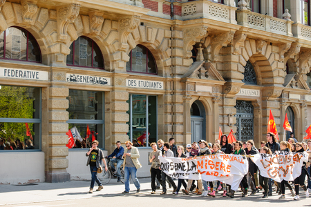 socialist: STRASBOURG, FRANCE - APR 20, 2016: Passing near University food court of hundreds of students demonstrate as part of nationwide day of protest against proposed labor reforms by Socialist Government