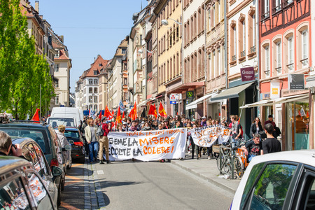 proposed: STRASBOURG, FRANCE - APR 20, 2016: Central street of Rue du Vieux Marche aux Poissons closed as hundreds demonstrate as part of nationwide day of protest against proposed labor reforms by Socialist Government