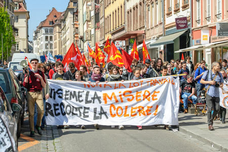 aux: STRASBOURG, FRANCE - APR 20, 2016: Central street of Rue du Vieux Marche aux Poissons closed as hundreds demonstrate as part of nationwide day of protest against proposed labor reforms by Socialist Government