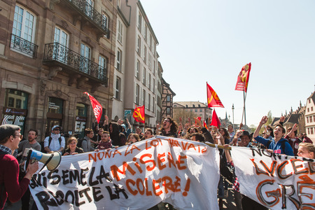 nationwide: STRASBOURG, FRANCE - APR 20, 2016:  Hundreds of students jumping during protest as part of nationwide day of protest against proposed labor reforms by Socialist Government