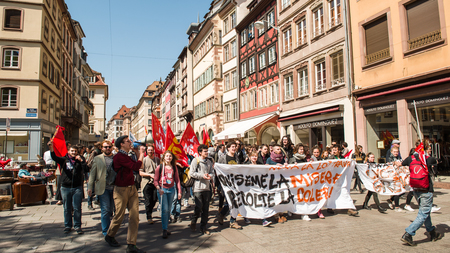 nationwide: STRASBOURG, FRANCE - APR 20, 2016: Central street of Rue du Vieux Marche aux Poissons closed as hundreds demonstrate as part of nationwide day of protest against proposed labor reforms by Socialist Government