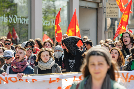 nationwide: STRASBOURG, FRANCE - APR 20, 2016: Crowd yelling as hundreds of people demonstrate as part of nationwide day of protest against proposed labor reforms by Socialist Government