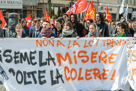 socialist: STRASBOURG, FRANCE - APR 20, 2016: Marching and closed central street as hundreds of people demonstrate as part of nationwide day of protest against proposed labor reforms by Socialist Government
