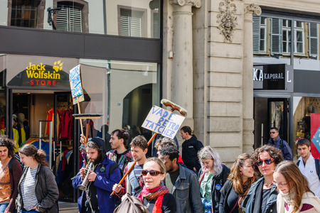 central government: STRASBOURG, FRANCE - APR 20, 2016:Closed central street as hundreds of people demonstrate as part of nationwide day of protest against proposed labor reforms by Socialist Government