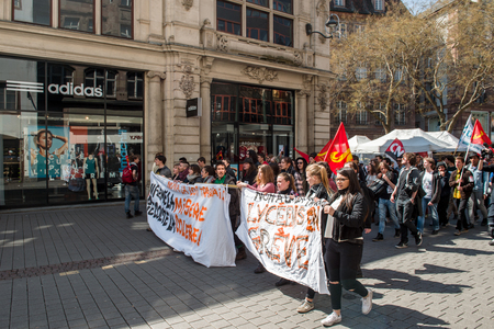 proposed: STRASBOURG, FRANCE - APR 20, 2016: Closed central shopping street as hundreds of people demonstrate as part of nationwide day of protest against proposed labor reforms by Socialist Government
