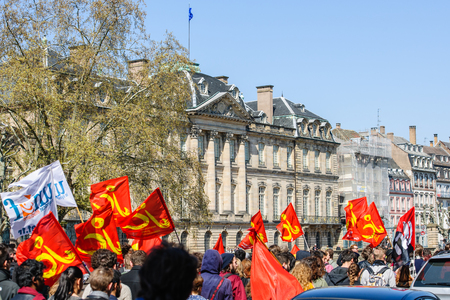 proposed: STRASBOURG, FRANCE - APR 20, 2016: Hundreds of people demonstrate with Palais Rohan behind as part of nationwide day of protest against proposed labor reforms by Socialist Government