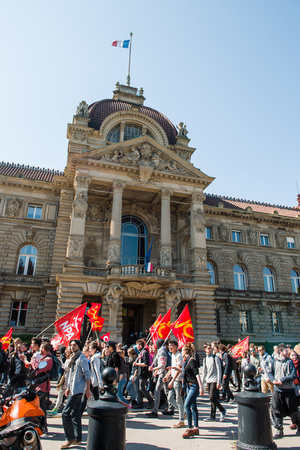 socialist: STRASBOURG, FRANCE - APR 20, 2016: Place de la republique with Palais du Rihn in the background and hundreds of people demonstrate as part of nationwide day of protest against proposed labor reforms by Socialist Government