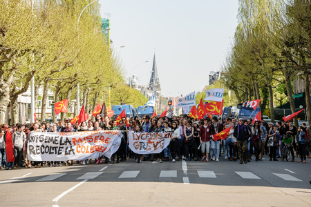 nationwide: STRASBOURG, FRANCE - APR 20, 2016: Closed Avenue des Vosges as hundreds of people demonstrate as part of nationwide day of protest against proposed labor reforms by Socialist Government