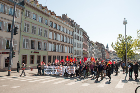proposed: STRASBOURG, FRANCE - APR 20, 2016: Closed main Strasbourg street as hundreds of people demonstrate as part of nationwide day of protest against proposed labor reforms by Socialist Government
