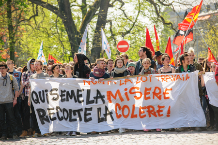 reforms: STRASBOURG, FRANCE - APR 20, 2016: Closed central street as hundreds of people demonstrate as part of nationwide day of protest against proposed labor reforms by Socialist Government