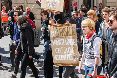 nationwide: STRASBOURG, FRANCE - APR 20, 2016: Young students on street demonstrate as part of nationwide day of protest against proposed labor reforms by Socialist Government Editorial