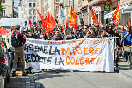 reforms: STRASBOURG, FRANCE - APR 20, 2016: Central street of Rue du Vieux Marche aux Poissons closed as hundreds demonstrate as part of nationwide day of protest against proposed labor reforms by Socialist Government