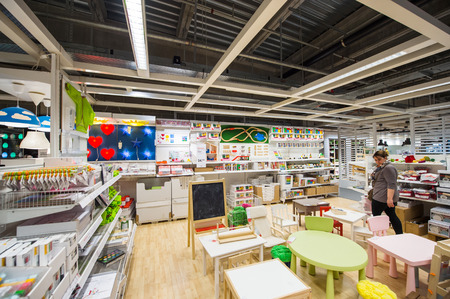 ikea: PARIS, FRANCE - APR 12, 2016: Woman choosing kids furniture in IKEA Shoping furniture store in PAris, France