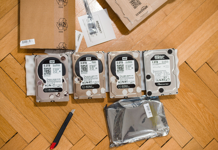 ranging: PARIS, FRANCE - MAR 18, 2016: Multiple Western Digital Hard disk drive with diverse capacity ranging from 1 tb to 6 tb arranged on floor after Amazon.com product e-commerce unboxing