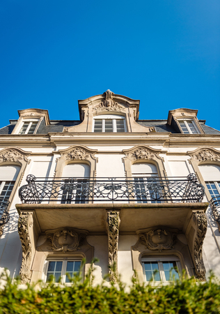 building estate: View from the street of beautiful french real estate building against clear blue sky