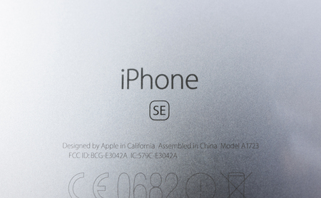 retina: PARIS, FRANCE - APR 21, 2016: The new Apple iPhone SE combining the updated processor, 4K rear camera, touch id, retina display