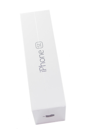 display retina: PARIS, FRANCE - APR 21, 2016: Side view of the packaging box of the new Apple iPhone SE combining the updated processor, 4K rear camera, touch id, retina display