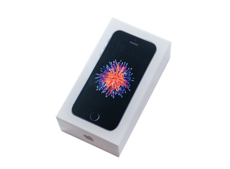 retina display: PARIS, FRANCE - APR 21, 2016: packaging box of the new Apple iPhone SE combining the updated processor, 4K rear camera, touch id, retina display